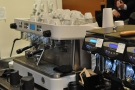 The espresso machine's business-end is visible from the till, but you can't really stand & watch.