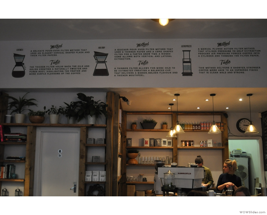 The counter is at the back, with a description of the pour-over methods on the wall above.