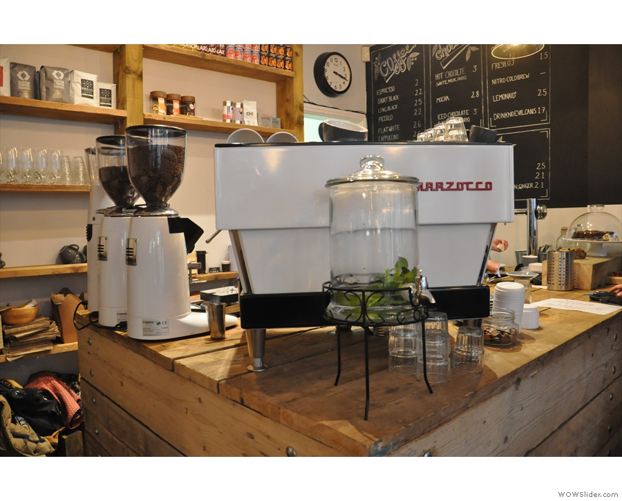 The espresso machine, a strikingly white La Marzocco, unusually on the corner of the counter.