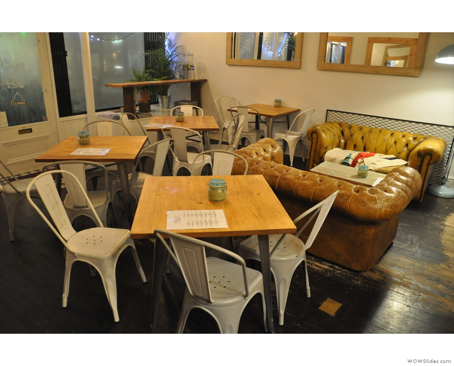 The bulk of the seating consists of these four four-person tables and the pair of sofas.