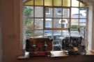 The window display has changed too, with these two old lever espresso machines in place.
