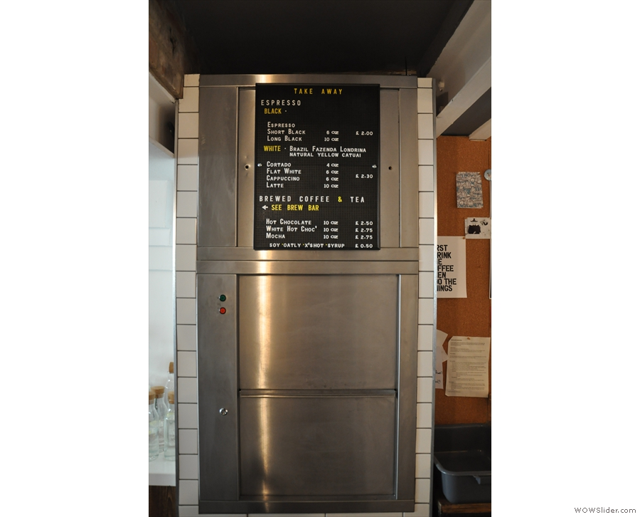 However, if you're wondering where the breakfast/lunch comes from, here's a clue. The dumb waiter beneath the coffee menu connects with the kitchen in the basement. Mystery solved!