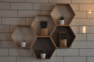 Cartwheel is full of neat things, inclduing these hexagonal storage units on the tiled wall.