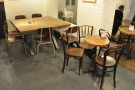 The counter's on the left, with more seating opposite, including these tables at the back.