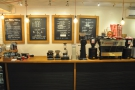 The counter, with cakes and till to the left, filter coffee in the middle, espresso on the right.