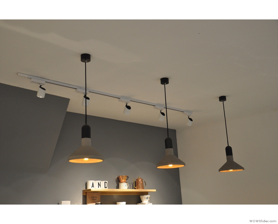 ... while the lights add a certain warmth (as does the wood of the table and counter).