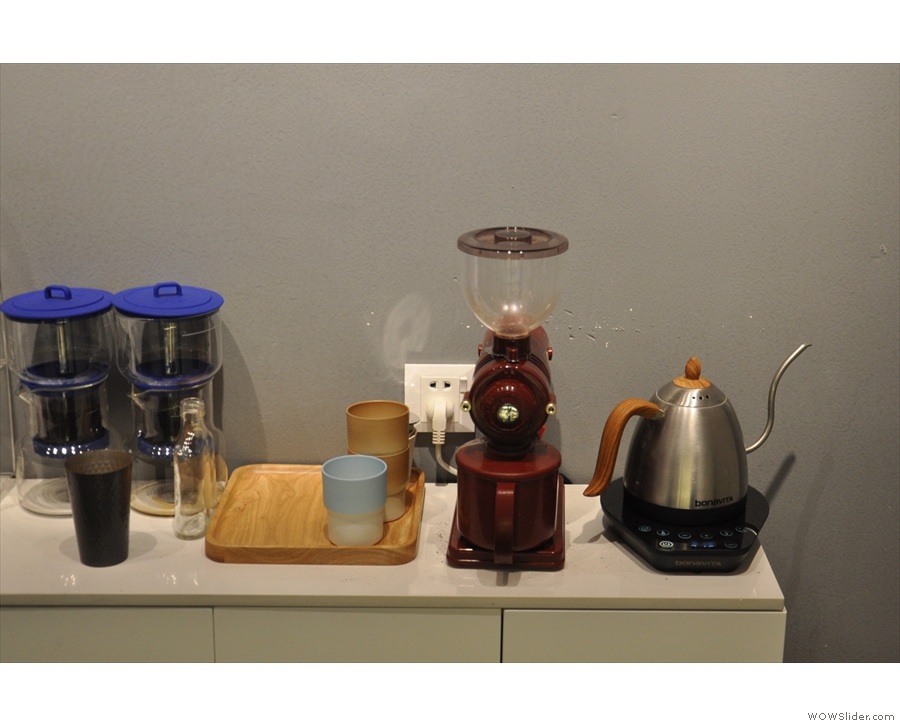 The pour-over gear is on the shelf at the back behind the counter...