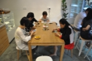 The communal table occupies the centre of the room...