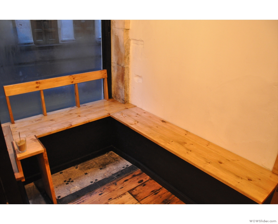 All around it has been done out in wood. This is one of the window seating areas. On my first visit, I sat in the other one, on the other side of the door...