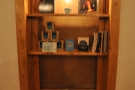 I like the clever use of space: this was an old window, now a set of shelves.