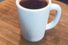 My coffee, a Tairora from Papua New Guinea, through the Chemex and served in a tall mug.