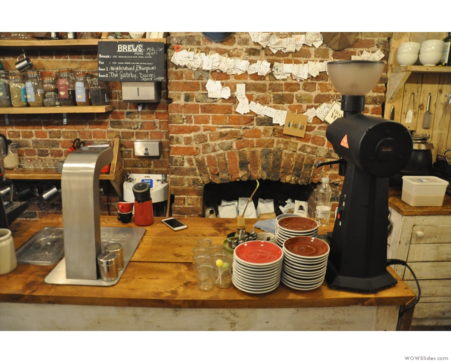 The filter part of the operation is at the far end of the counter, where it has its own grinder.
