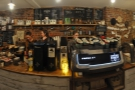 The counter, which dominates the front room, has the coffee kit on the long side.