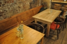 Finally there are two more tables along the left-hand wall. A four-person one at the back...