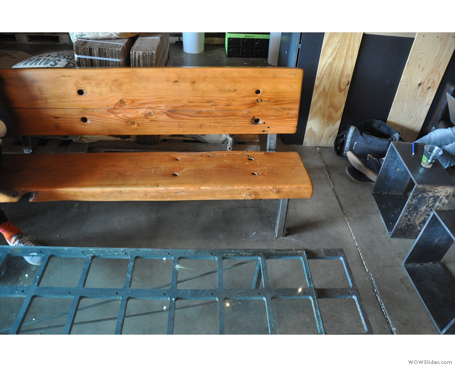 ... although there's an eclectic collection of seating, including this bench, to the door's left.
