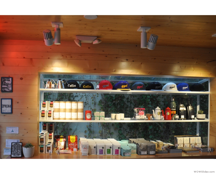 Opposite the counter is a set of retail shelves.