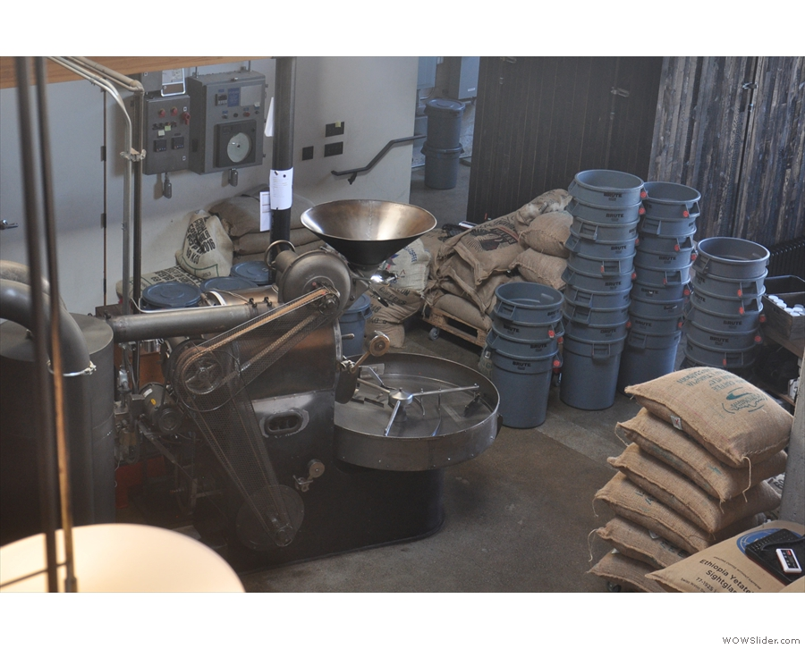 Pride of place goes to this vintage Probat roaster, surrounded by sacks of green beans.