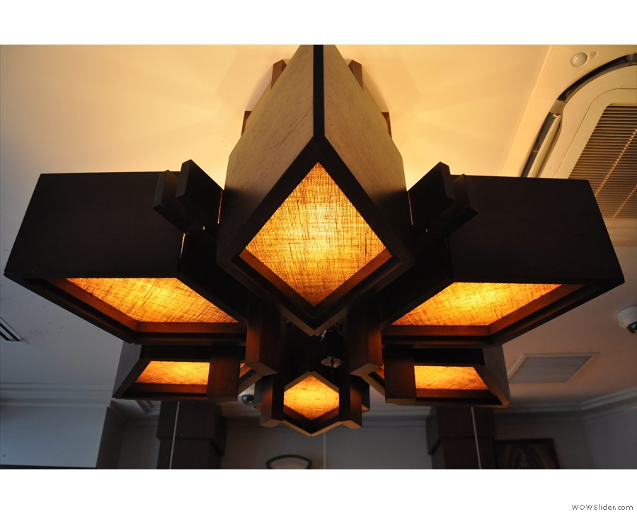 Naturally, it's lighting central in here. This beautiful construction hangs over the counter.