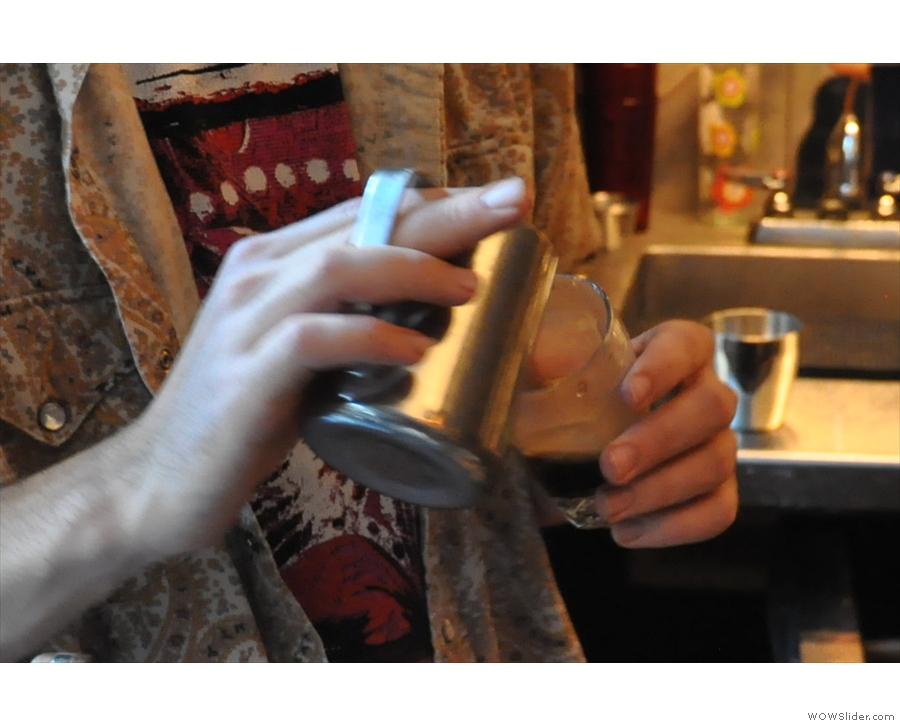 The initial pour mixes the milk and coffee...