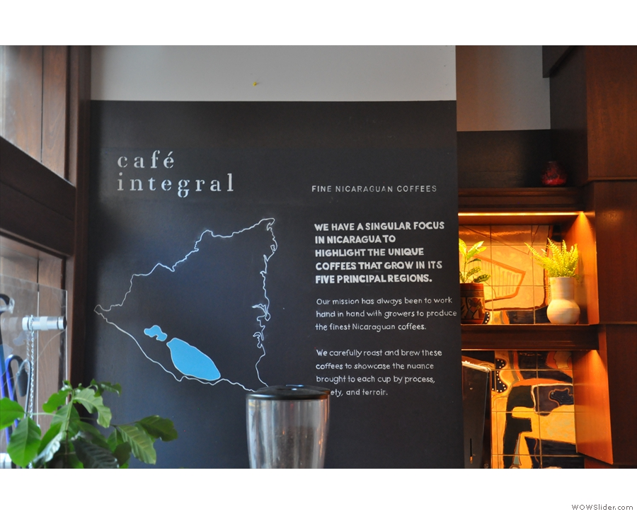 Café Integral's mission statement is written up on the wall by the window.