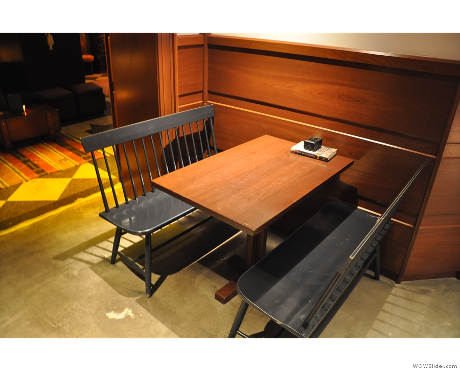 ... wihle on the right, as the space narrows, is this four-person table.
