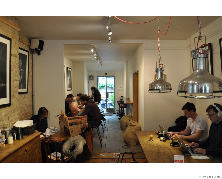 Past the counter, Hot Numbers narrows & there's more seating, including a communal table.