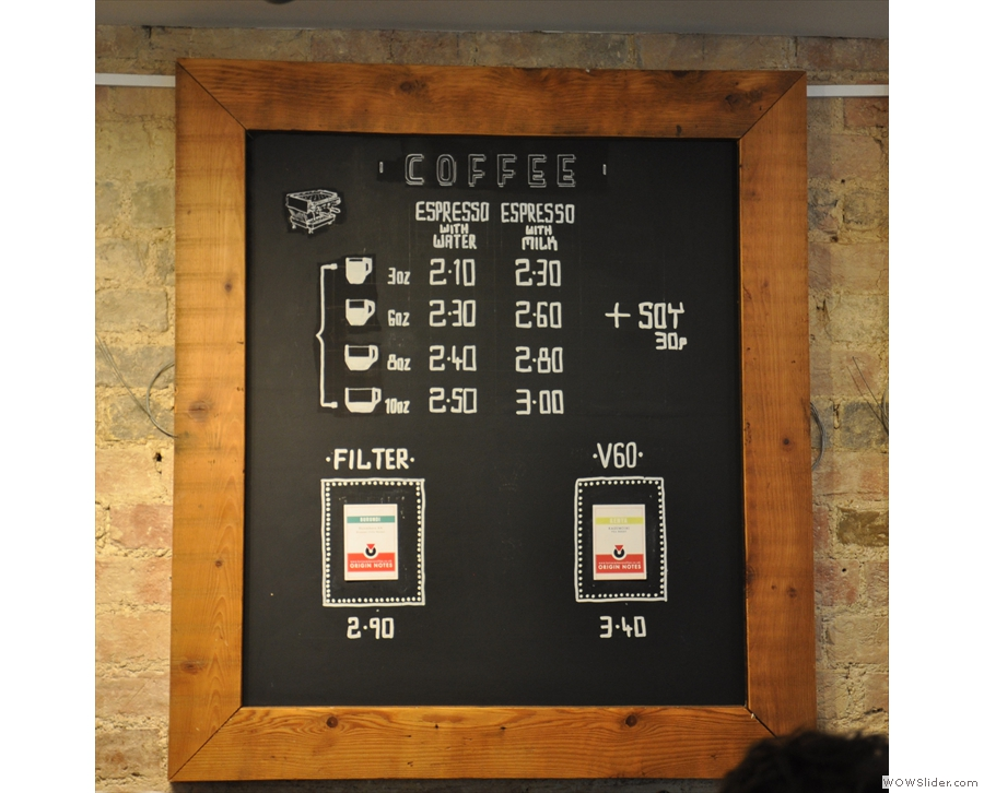 The menus are on the wall behind the counter: this is the nameless coffee menu...