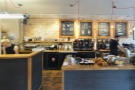 The counter is a two-part affair, a prep area to the left, coffee, etc, to the right.