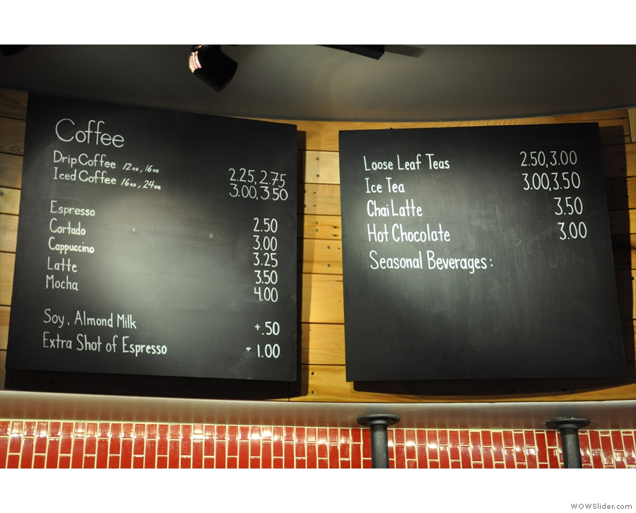 The coffee (and other drinks) menu is on the wall above the counter...