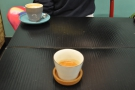 Our two coffees, eyeing each other suspiciously across the table.