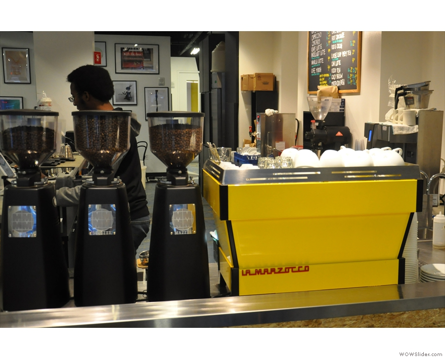 The bright yellow La Marzocco espresso machine has pride of place at the front of the counter.
