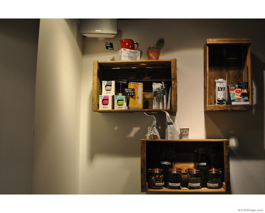 ... with a small set of retail shelves on the wall above.