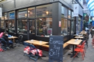 There's plenty of outside seating, a feature of Brixton Village. Some is on the short side...
