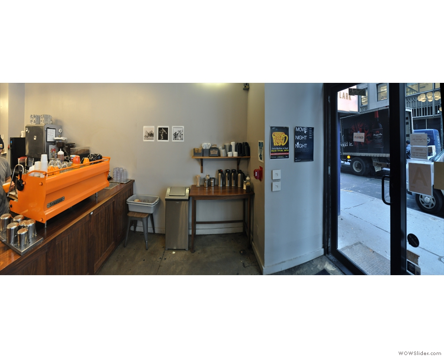 The door is on the right, leaving a large space for those waiting for their coffee.