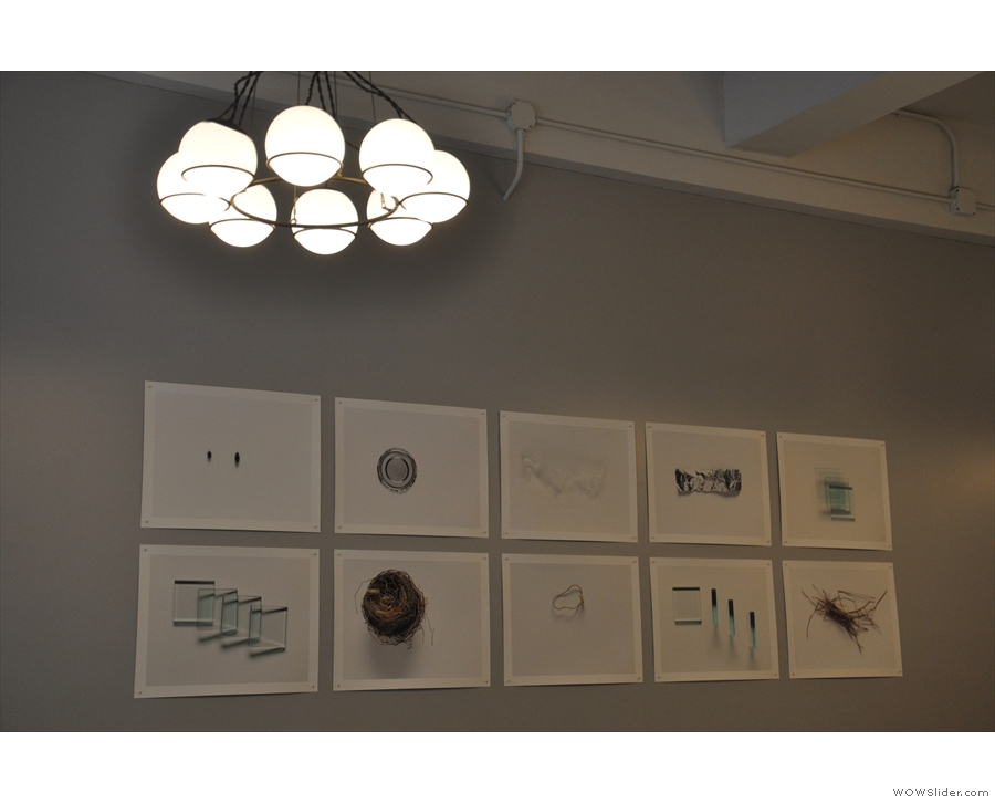 Various works of art by local artists hang on the walls. These are by Eileen Travell.