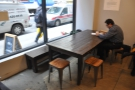 There's a communal table in the window on the left-hand side...