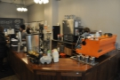 The counter is on the right-hand side, it's bright Synesso greeting you as you enter.