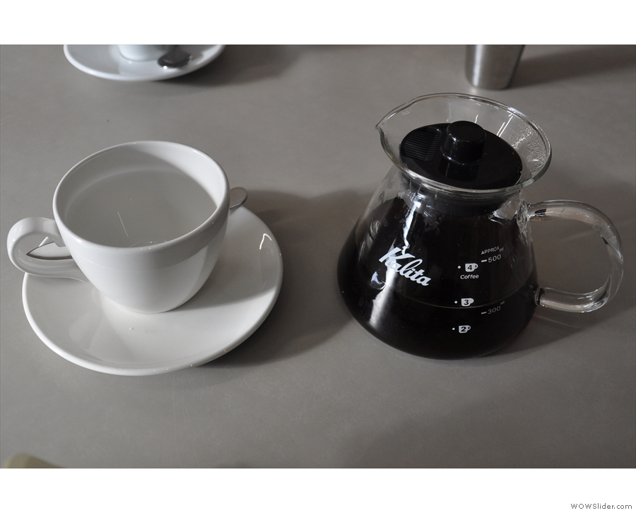 My coffee, served as it should be, in a carafe with a cup on the side.