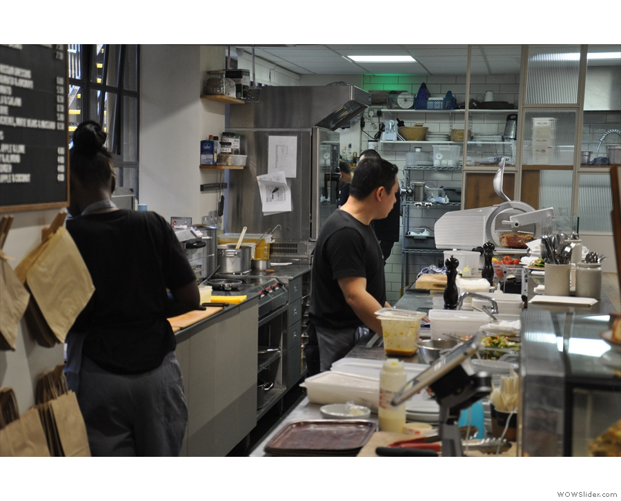 ... where you can watch the kitchen staff at work.