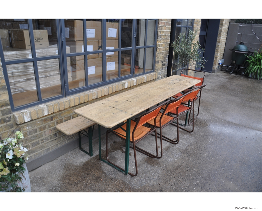 ... while to the right of the door there's this long, communal table...