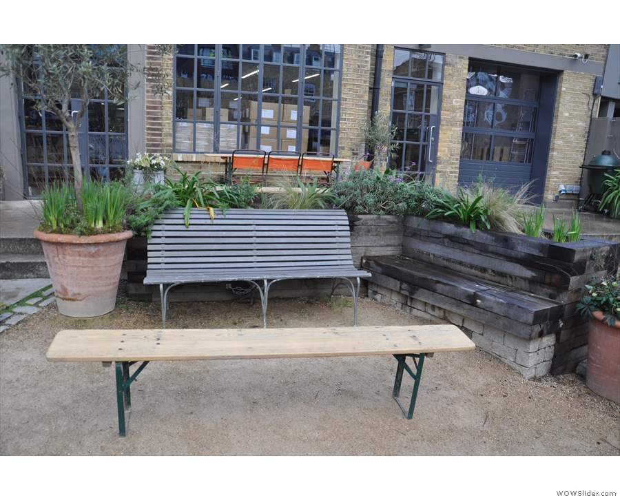 There are these two benches with their coffee table off to the right...