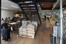 Stepping inside, the cafe is ahead and to the left, with the roastery to the right...