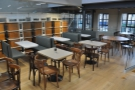 ... to the right of the stairs, a row of tables & a row of booths overlooking the roastery.