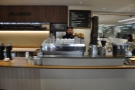 The espresso machine is front and centre, with the till to the right...