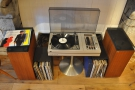 ... which houses a turntable and a large collection of records.