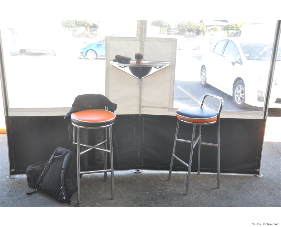 There's also a lean-to type arrangement at the front with two stools if you want to sit down.
