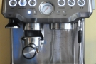 So, let's put the Barista Express through its paces! First, slot the portafilter into the grinder.