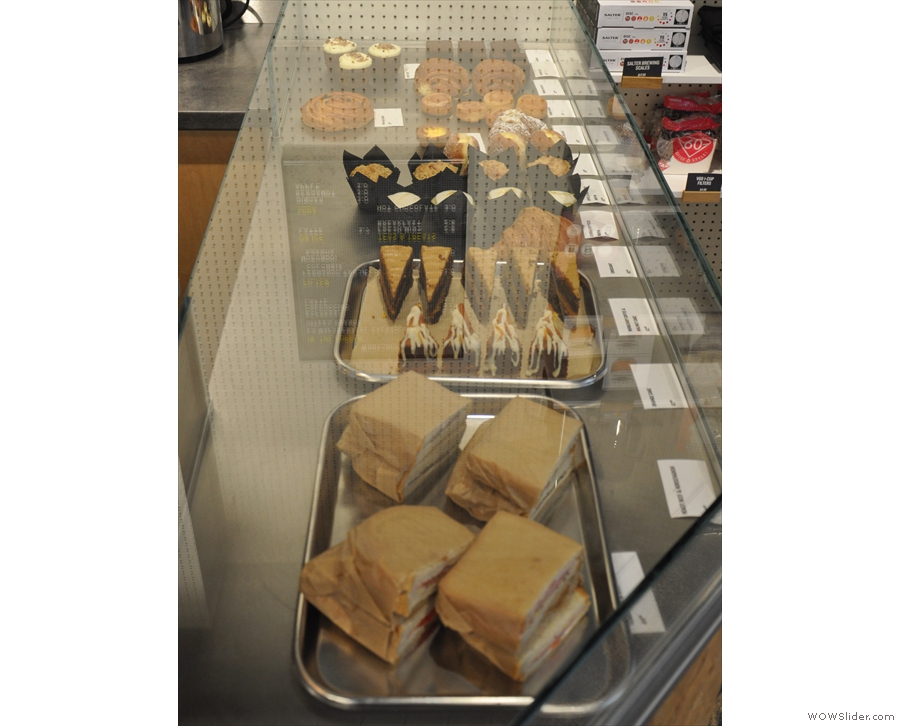 In contrast, the cakes (& sandwiches) are in a display case at the front, opposite the door.