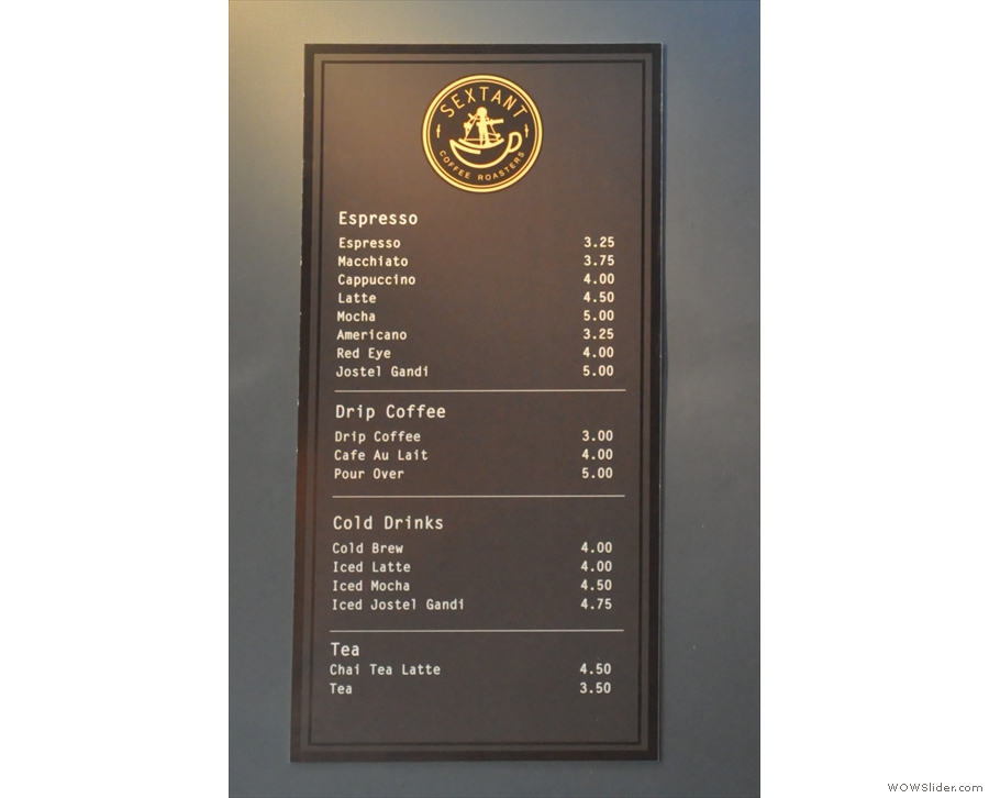 The coffee menu is also on the left-hand wall, just a little further back above the counter.