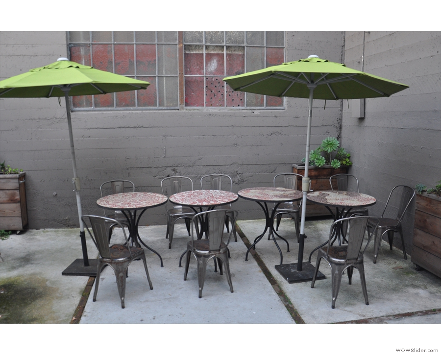This leads to a secluded courtyard with more seating in the form of small, round tables.